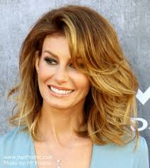 Faith Hill | Voluminous medium length hairstyle with an ombre color effect